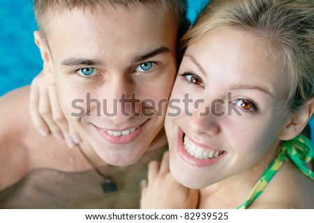 Close-up portrait of a teenage couple in a swimming pool