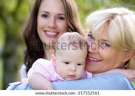 Close up portrait of a three female generations