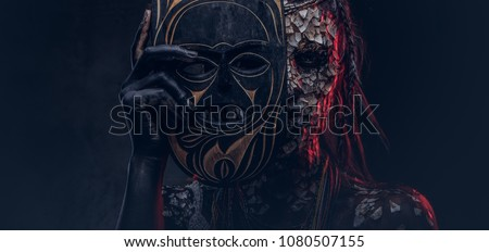 Close-up portrait of a witch from the indigenous African tribe, wearing traditional costume. Make-up concept. ストックフォト ©
