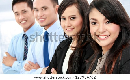 close up Portrait of a woman and man office workers smiling isolated on white background