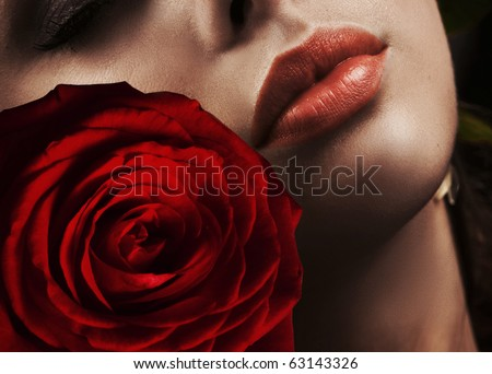 Close up portrait of a woman with rose