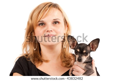 Close up portrait of a young blonde lady with her chihuahua