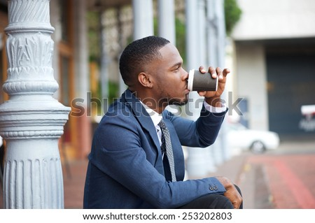 Close up portrait of a young businessman relaxing and drinking coffee in the city #253202803