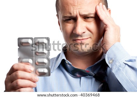 Close up portrait of a young businessman with strong headache