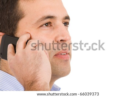 Close-up portrait of a young casual man on the phone. Isolated on white