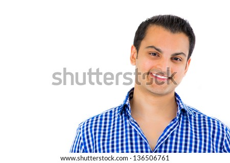 Close-up portrait of a young happy attractive guy isolated on white background with copy space