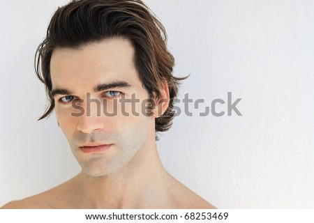 Close up portrait of a young man against white background