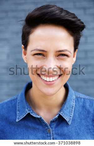 Close up portrait of a young modern woman with short hair smiling  - Shutterstock ID 371038898