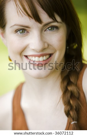 Close-up portrait of a young pretty woman smiling