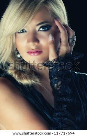 Close-up portrait of a young sexy blond woman, studio shot