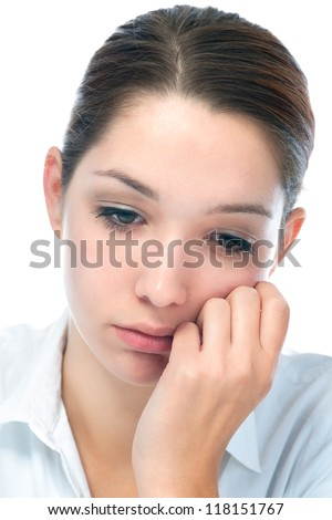 Close up portrait of a young woman with sad expression