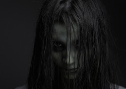 Close up portrait of a zombie girl with horror expression
