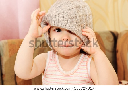 Close up portrait of adorable baby wearing  knit winter cap