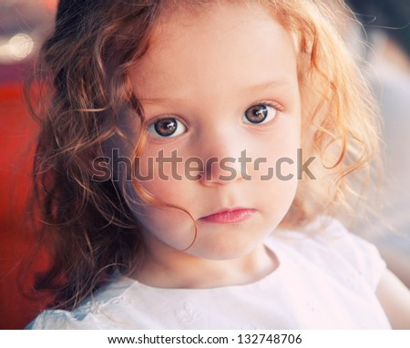 Close up portrait of adorable 3 years old girl