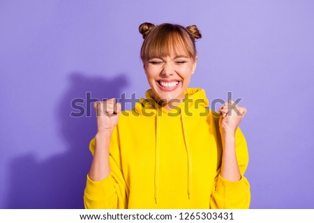Close up portrait of amazing beautiful brunette she her lady pretty hairdo fists raised in air mouth eyes tight closed unbelievable wearing casual bright yellow pullover isolated on purple background