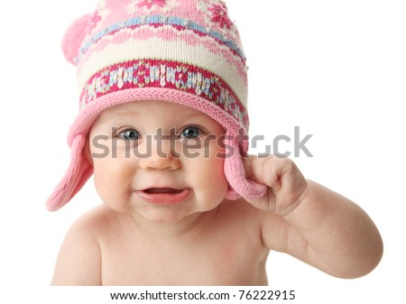 Close up portrait of an adorable baby wearing a knit winter cap, isolated on white