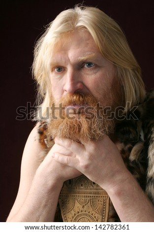 Close Up Portrait Of An Adult Male With Long Hair Blonde With A Red Beard And Mustache Wearing A Fur Dress Looking In The Direction Of Stock Images Page Everypixel