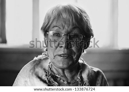 Close up portrait of an old grandmother in glasses