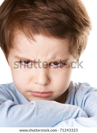 Close-up portrait of angry little boy isolated on white background