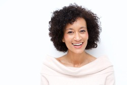 Close up portrait of attractive middle age african american woman smiling against white background