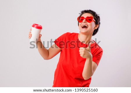 Close-up portrait of attractive pretty cute stylish cute cute cute funny brunette in everyday red t-shirt holding looking at paper Cup of coffee isolated on white background,concept of love for coffe #1390525160