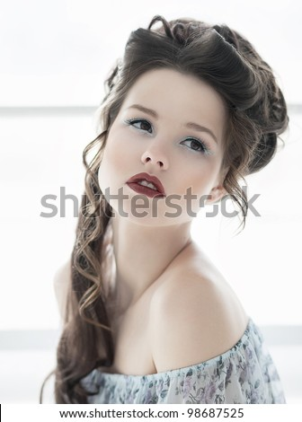 Close-up portrait of attractive young model girl with bright make-up and hairstyle. Serene sexy woman - stock photo