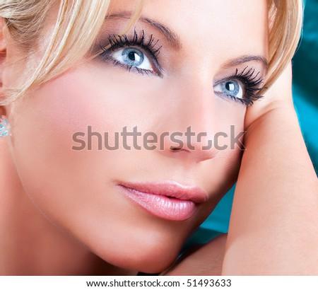 Close up portrait of beautiful  adult woman with blue eyes , studio shot