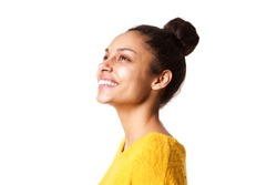 Close up portrait of beautiful african lady looking away and smiling on white background