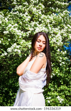 Close-up portrait of beautiful asian young woman resting on nature
