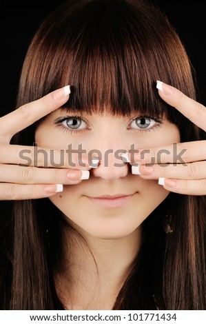 Close-up portrait of beautiful brunette girl with manicure