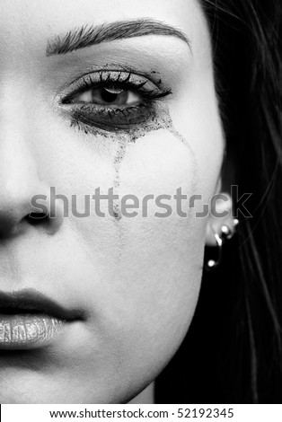 close-up portrait of beautiful crying girl with smeared mascara