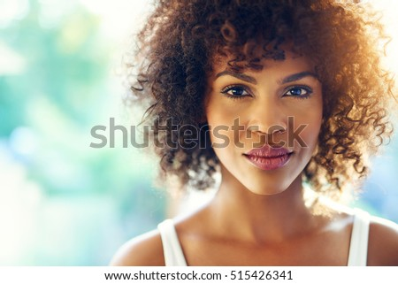 Close up portrait of beautiful curly girl looking at camera emotionless. Copyspace #515426341