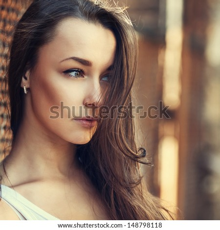 Close-up portrait of beautiful cute sexy girl in profile