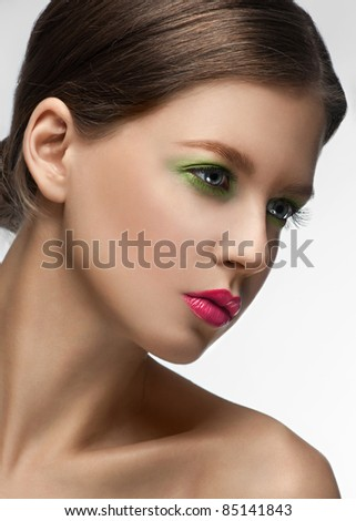 Close-up portrait of beautiful elegant woman with bright fashion make-up