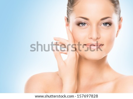 Close-Up Portrait Of Beautiful, Fresh, Healthy And Sensual Girl Over Blue Background