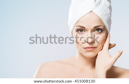 Shutterstock Close-up portrait of beautiful, fresh, healthy and sensual girl with arrows on her face. Medicine, spa and skin care concept.