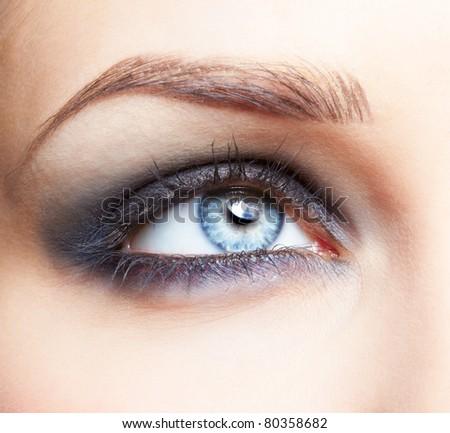 close-up portrait of beautiful girl's eye zone make up