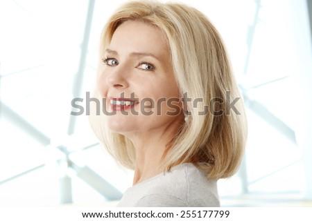 Close-up portrait of beautiful mature woman smiling.