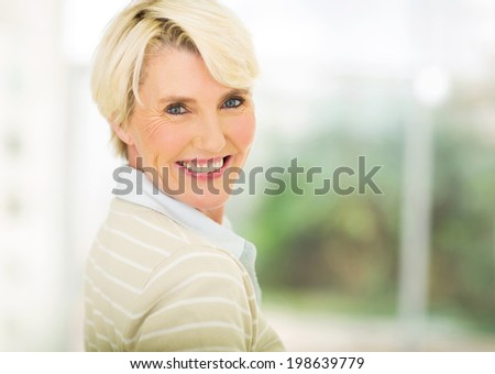 close up portrait of beautiful middle aged woman indoors #198639779