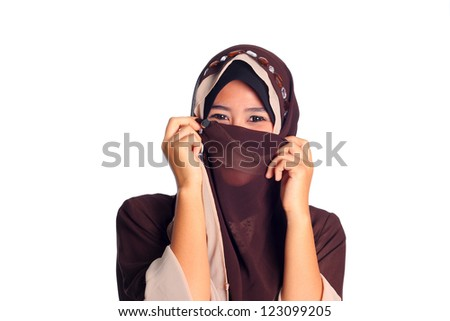 Close-up portrait of beautiful Muslim girl gazing steadily at the camera isolated on white
