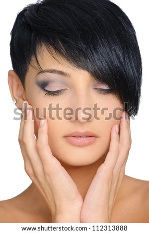 Close-up portrait of beautiful woman on white background