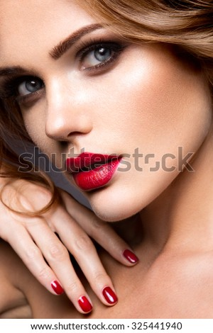 Stock Photo Close-up portrait of beautiful woman with bright make-up