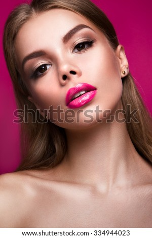 Stock Photo Close-up portrait of beautiful woman with bright make-up and pink lips