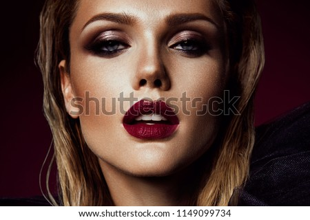 Stock Photo Close-up portrait of beautiful woman with bright make-up and red lips
