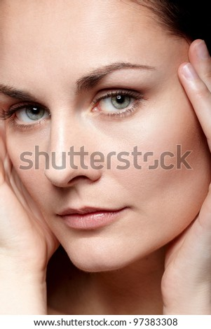 Close-up portrait of beautiful woman with perfect healthy skin and natural makeup