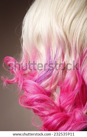 Close-up portrait of beautiful woman with pink hair