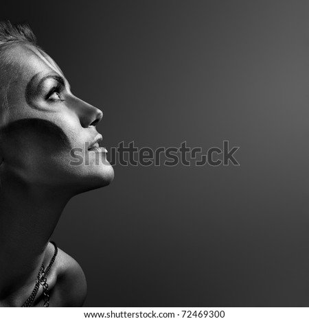 close-up portrait of beautiful woman with silver bodyart - bw image - stock photo