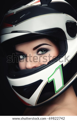 Close-up portrait of beautiful woman with stylish makeup in biker helmet