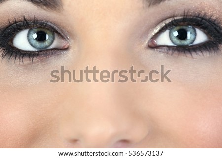 Close-up portrait of beautiful young blue-eyed woman  - Shutterstock ID 536573137
