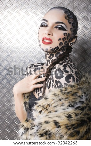 close-up portrait of beautiful young european model in cat make-up and bodyart
